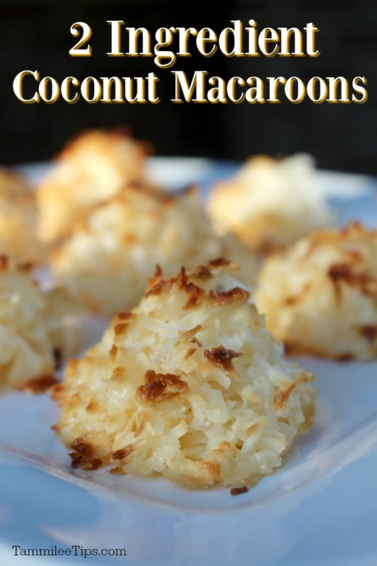 coconut macaroons on a white plate with a black background