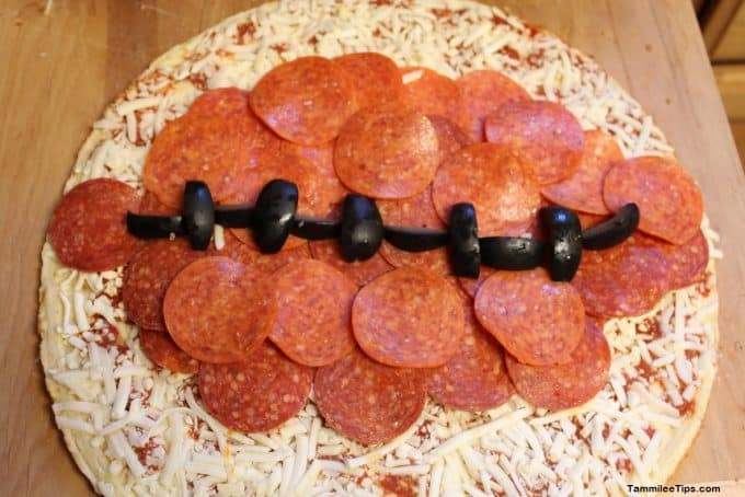 Last minute football party! Check out these Football Pizzas
