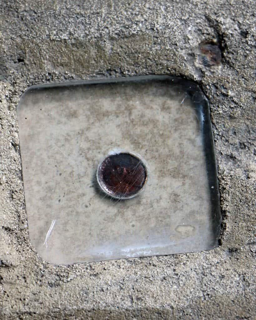 penny in concrete