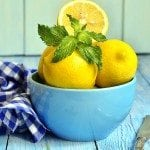 Lemons in a blue bowl.