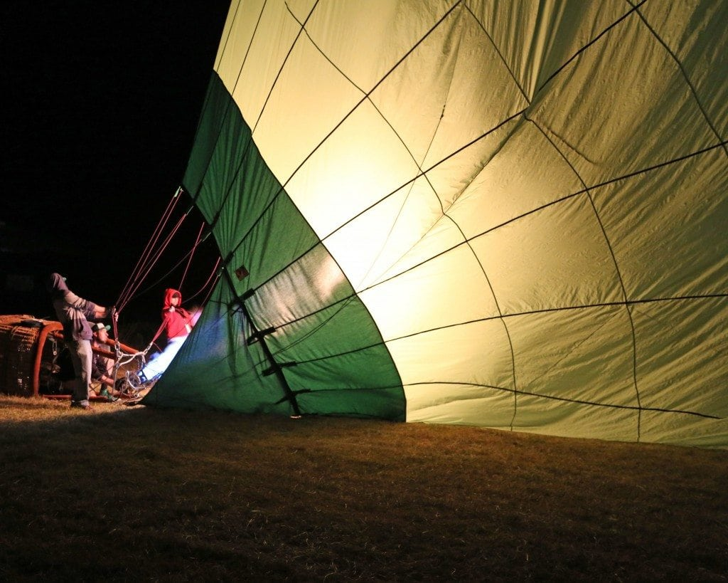 inflating hot air baloon in the dark