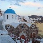 Sunset over church in Santorini Greece