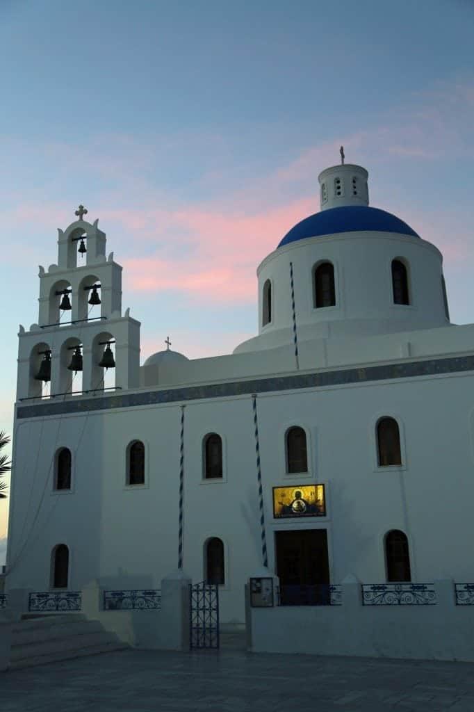 beautiful church at sunset in Santorini Greece