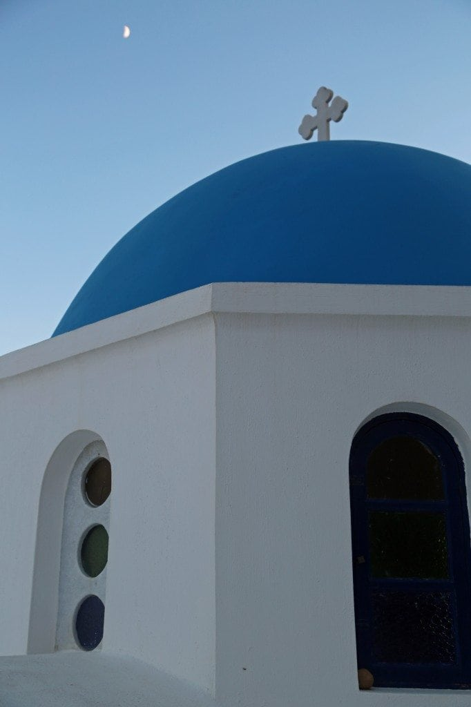 church with moon in Santorini Greece