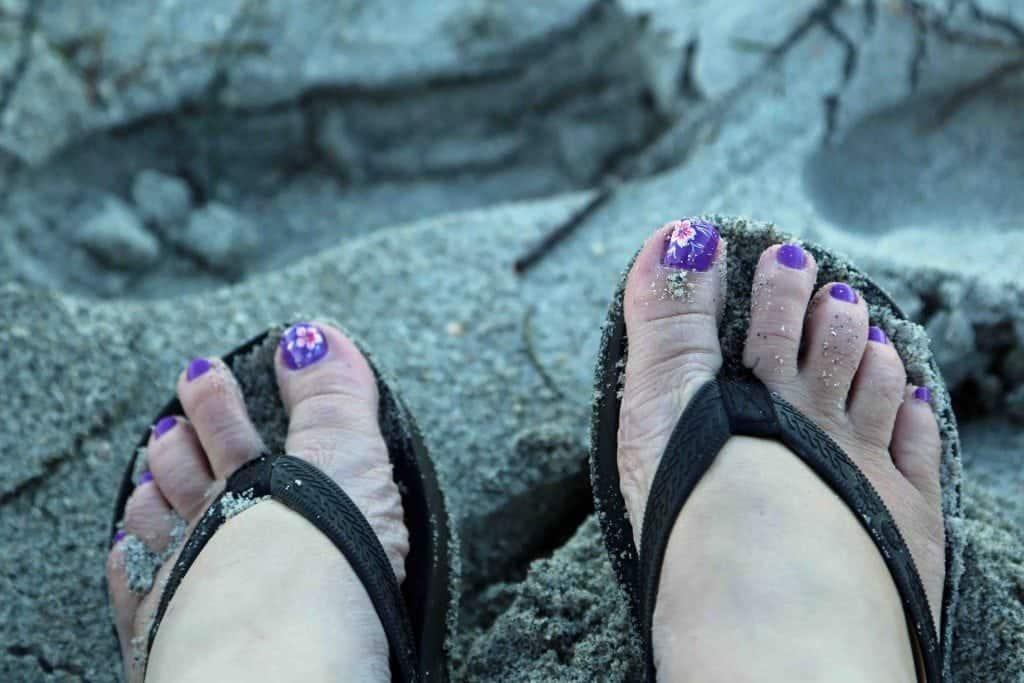 Feet in the sand at Sanibel Island Florida