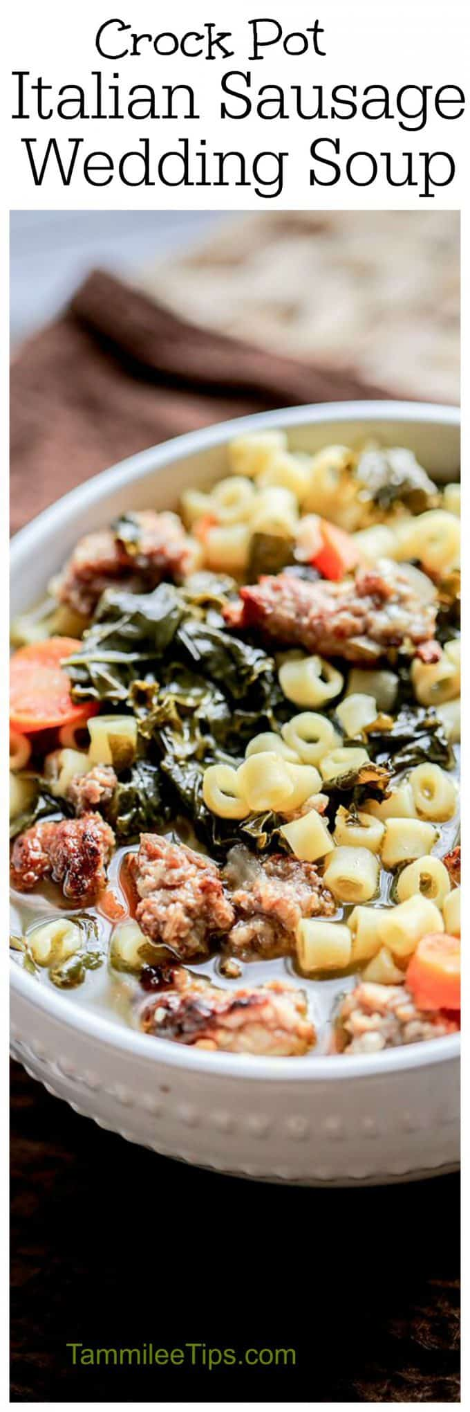 Easy slow cooker crock pot Italian Sausage Wedding Soup recipe that is the perfect comfort food for a winter night. Perfect for families dinners!