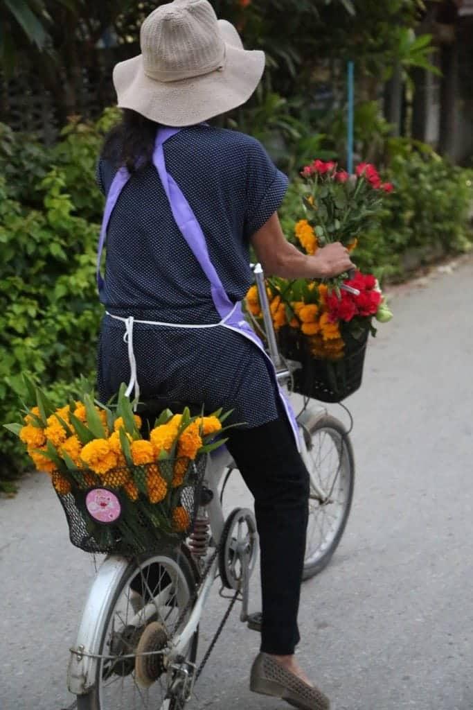 Flower seller on a bike in Northern Thailand