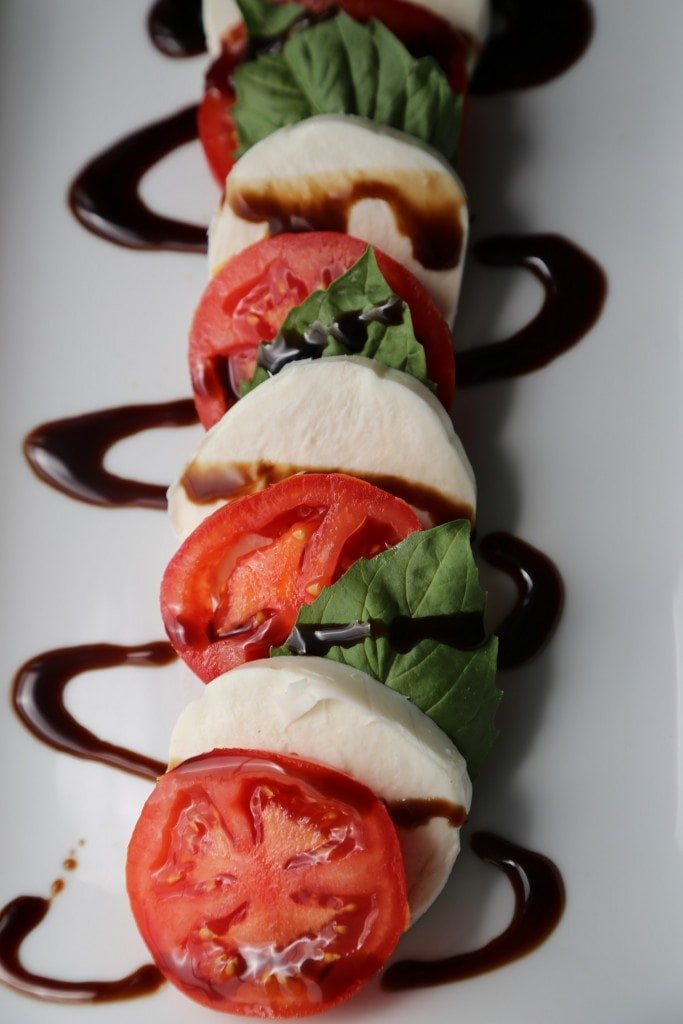 Seriously easy and oh so delicious Caprese Salad Recipe you can make right now! Great for a crowd or family dinner! 4 ingredients are all you need!