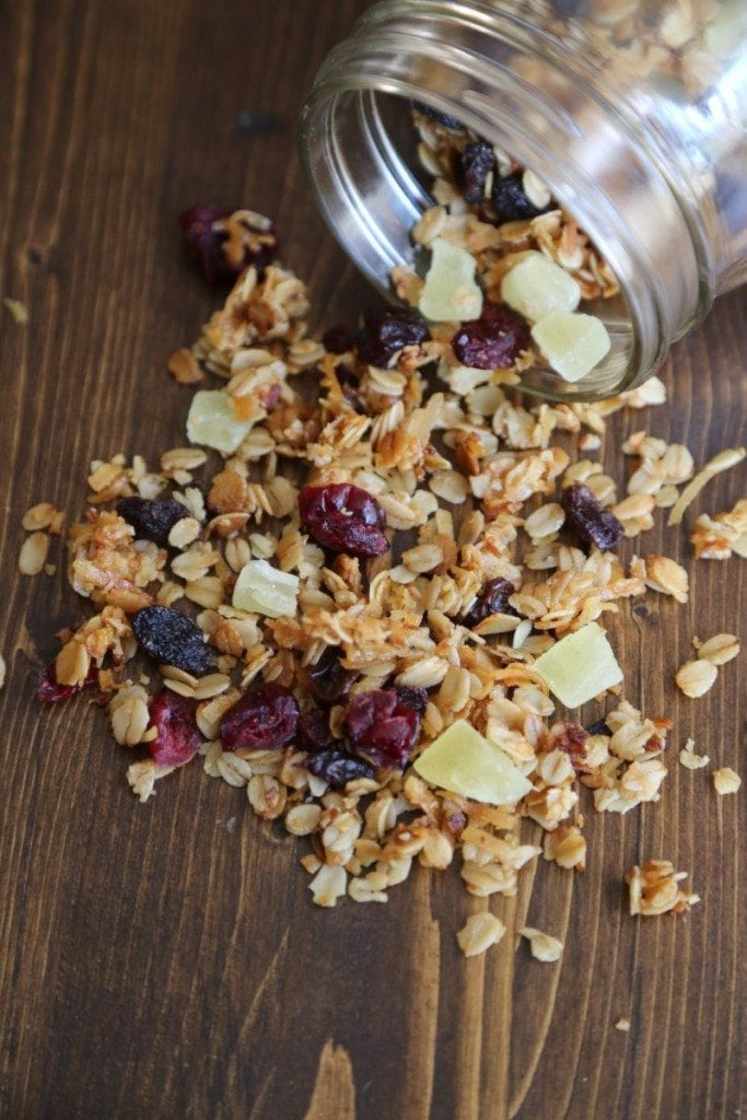 Super easy homemade crockpot Honey Granola with dried fruit recipe! yes, you really do make this recipe with the slow cooker.  This crock pot recipe is a great easy healthy snack