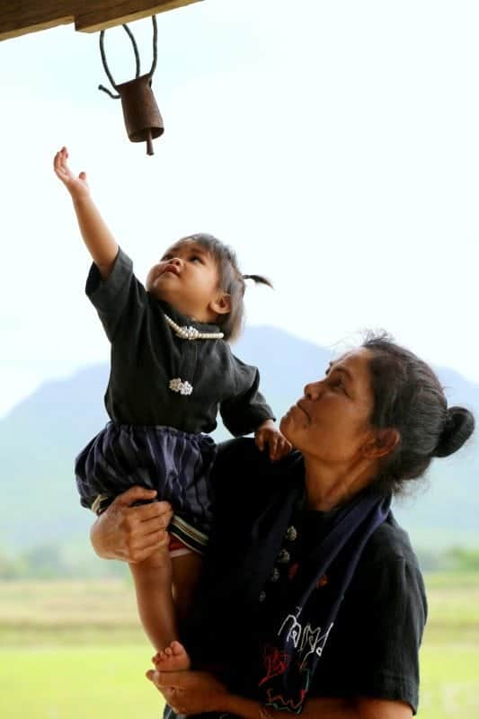 Thailand Grandmother and Granddaughter. Wishing and Caring