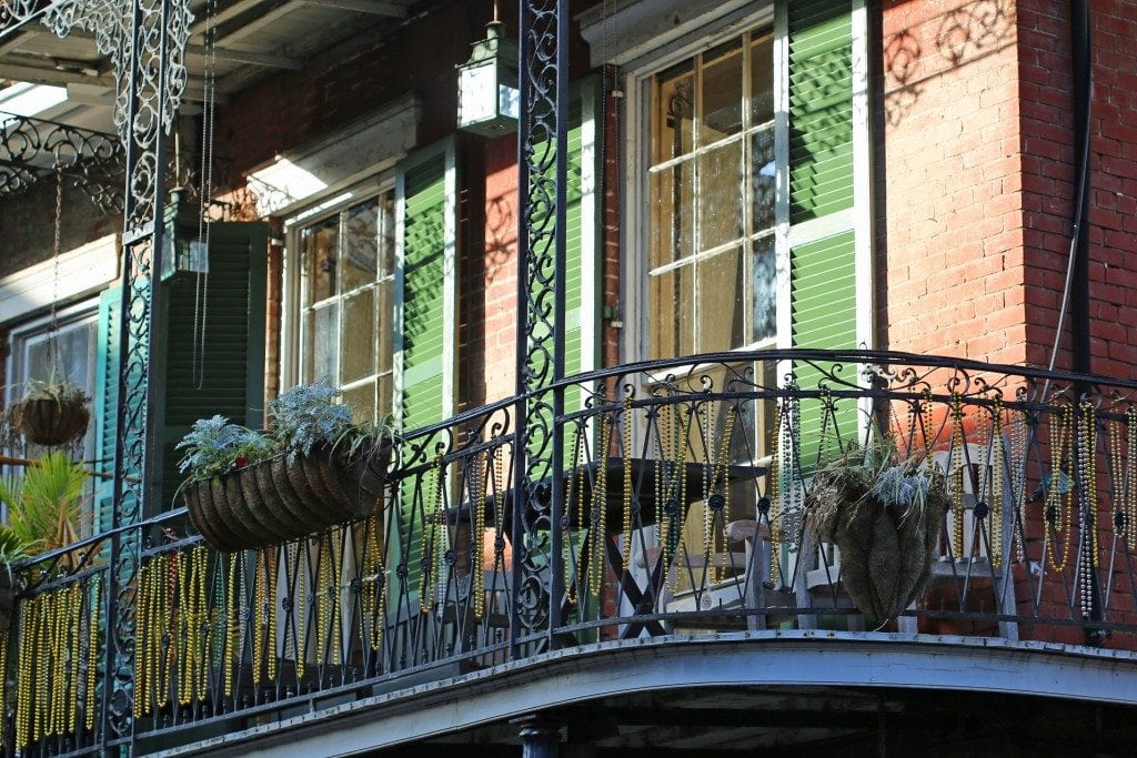 beads on deck railing French Quarter New Orleans