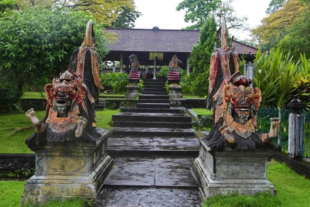 statues along walkway in Water Palace Bali