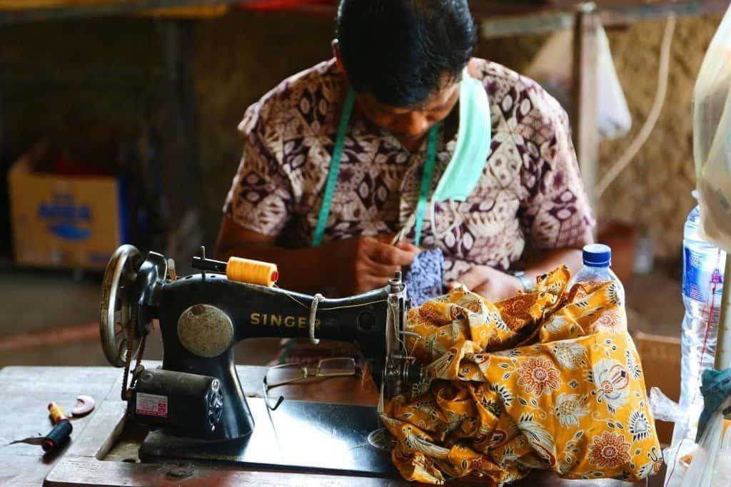 worker on sewing machine in Batik Factory