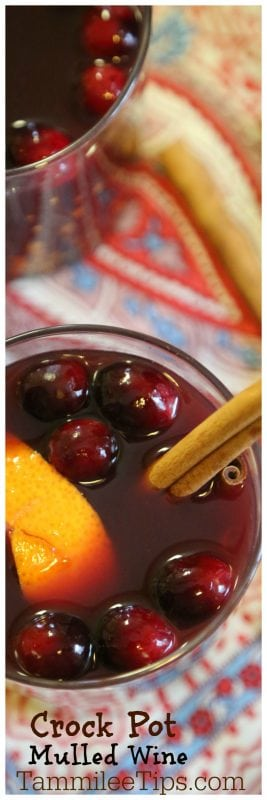 How to make Easy Crock Pot Hot Mulled Wine Recipe with cranberries! This slow cooker cocktail recipe is perfect for football parties or cold winter days! The crockpot does all the work! #crockpot #slowcooker #recipe #wine #cocktail #mulledwine #comfort