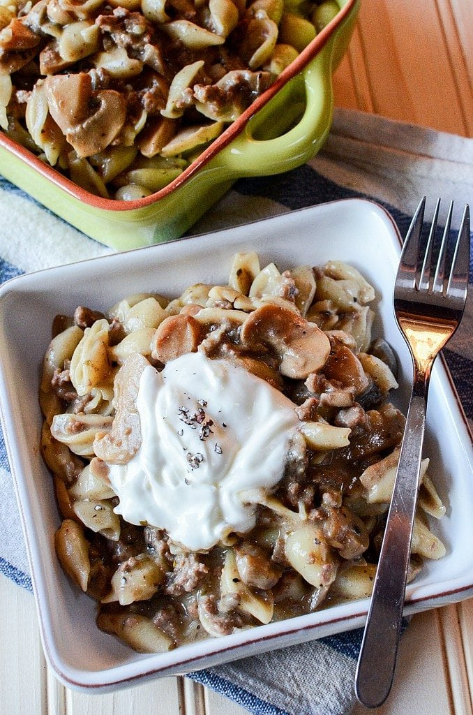 Crock Pot Mushroom, Ground Beef, Pasta Casserole Recipe with sour cream! This slow cooker crockpot casserole recipe is the perfect family dinners comfort food meal! Filled with beef and pasta your family will love it!