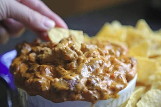 Meat Lovers Crock Pot Queso Dip Recipe! This is the perfect slow cooker appetizer recipe! Beef and bacon plus cheese what more can you ask for!