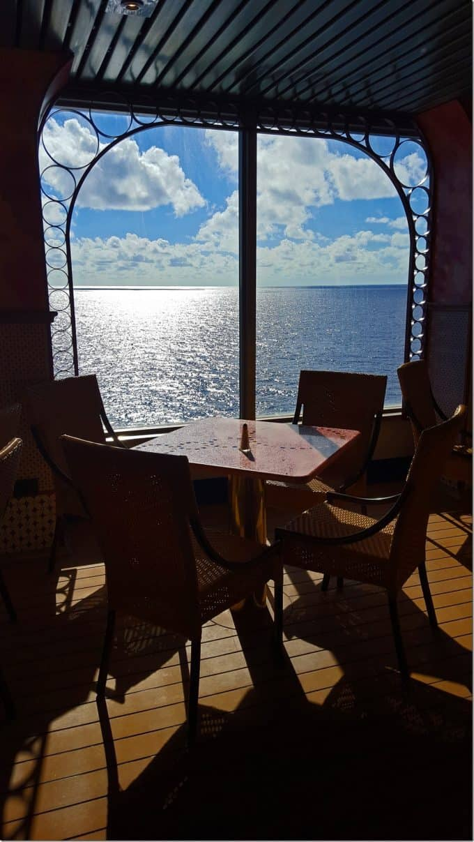 Eating on the Carnival Conquest looking out to sea