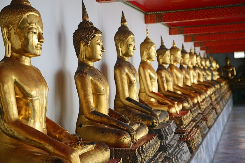 several statues at the Reclining Buddha