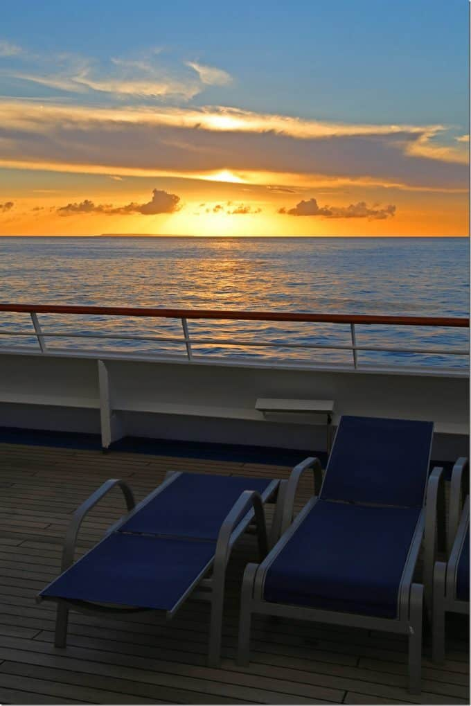sunset at sea on the upper deck of Carnival Conquest
