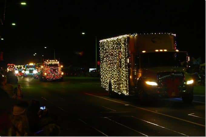 Row of Semi trucks coming down main street Waimea Hawaii