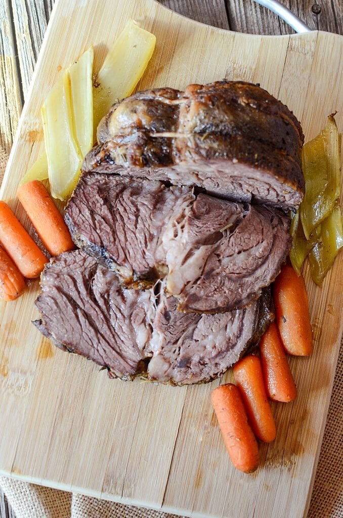 Easy Crock Pot Roast Recipe with vegetables! One of the best comfort food recipes we have! This potroast crock pot recipe is perfect for family dinner and leftovers! The slow cooker does all the work for this simple dinner recipe!
