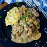 Crock Pot Creamy Rosemary Pork perfect over biscuits! This pork loin slow cooker recipe is easy to make and the perfect comfort food! Simple, easy, delicious and the crock pot does all the work! Yes please! The family will love this recipes for dinner! Plus the leftovers are amazing!