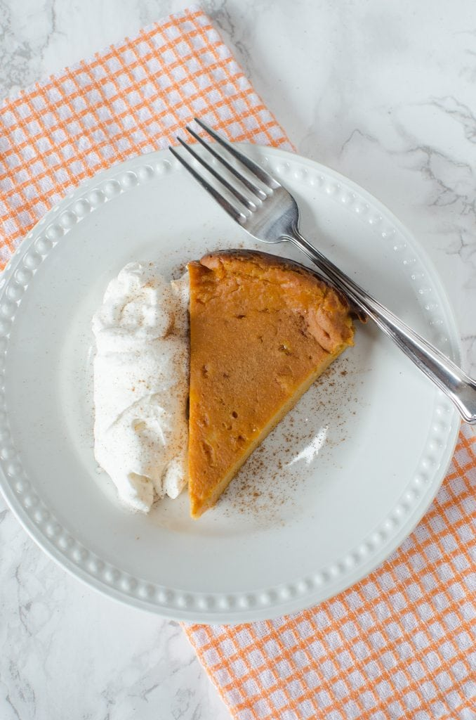 Super Easy Crock Pot Pumpkin Pie Pudding Cake! This dessert recipe is perfect for Fall, Thanksgiving, Christmas or any day you need a sweet treat. The slow cooker does all the work and you get a delicious cake to serve to your family!