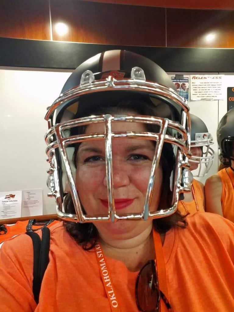 tammilee-with-osu-football-helmet-stillwater-oklahoma