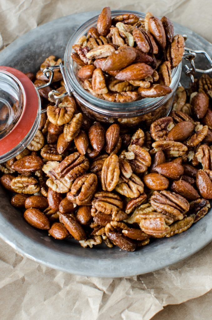 Crock Pot Sweet and Spicy Nuts Recipe perfect for Christmas! Super easy recipe that is great for DIY Holiday gifts. The crockpot/slow cooker does all the work and you have a great gift or snack!