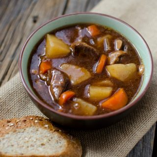 Slow Cooker Crock Pot Guinness Stew Recipe perfect for St. Patrick's Day meals! Perfect winter crockpot comfort food with beef and veggies. #crockpot #slowcooker #guinness #stpatricksday #stpattysday #comfortfood