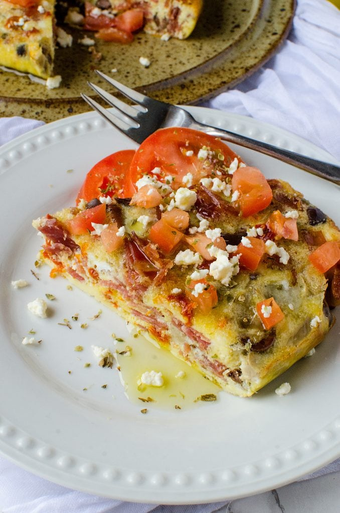 How to make Crock Pot Greek Frittata Recipe! eggs, sun-dried tomatoes, and more make this breakfast recipe beyond delicious!