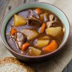 Slow Cooker Crock Pot Guinness Stew Recipe perfect for St. Patrick's Day meals! Perfect winter crockpot comfort food with beef and veggies.