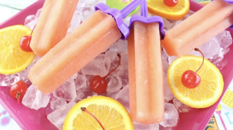 Bahama Mama Recipe for adult ice pops! The perfect cold treat on a hot summer day! Make a larger batch for summer parties, barbecues, tiki party, picnics and more! So easy to make