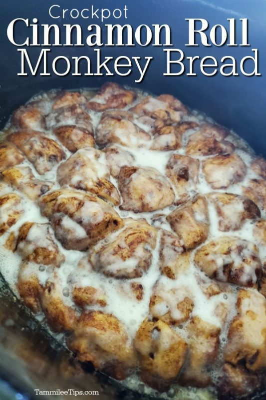 Crockpot Cinnamon Roll Monkey Bread in the crockpot with icing on it.